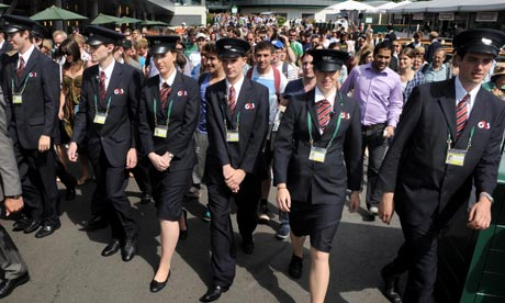 G4S Security staff holding back the crowd as the gates open during the 2011 Wimbledon Championships
