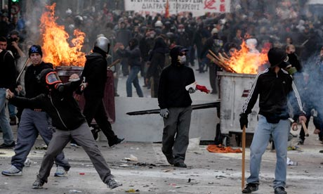 Flaming bins and masked protesters outside Athens parliament