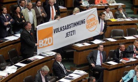 Buendnis Zukunft Oesterreich party (BZOe) hold up a banner reading 'referendum now'