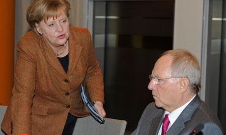 Angela Merkel talks to German finance minister Wolfgang Schäuble, 13 January 2012