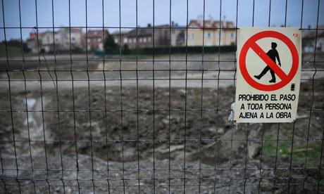 A sign warns people not to enter the prohibited area of a building site in northern Spain.