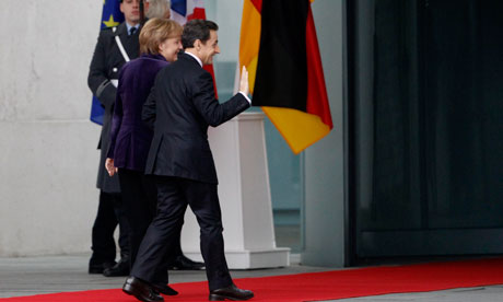 French President Sarkozy waves as he arrives to visit German Chancellor Merkel in Berlin