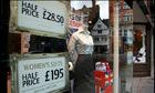 A high street shop window advertising a sale in Nottin