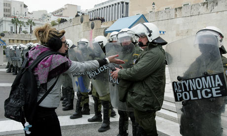 A protester speaks with police in front of the Greek Parliament in Athens, Greece, 10 February 2012.