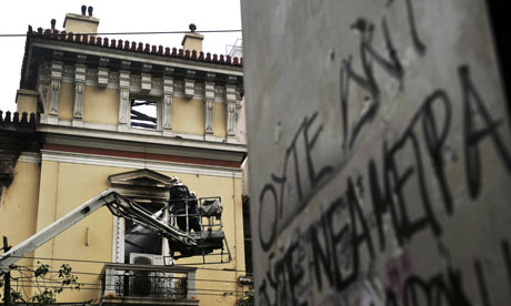 Firemen work on a damaged historic building in central Athens on February 13, 2012.