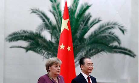 Angela Merkel attends an official welcoming ceremony with Chinese Premier Wen Jiabao.