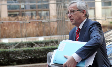 Jean-Claude Juncker arrives with a thick bundle of documents at a Euro Group meeting in Brussels.