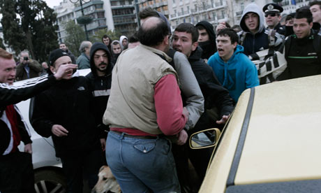 High school students scuffle with a driver outside the Greek Parliament. Monday, Feb. 20, 2012.