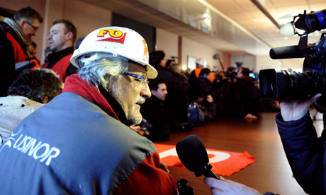 Workers occupy a meeting room on February 20, 2012 at a Arcelor Mittal plant.