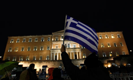 A protester holds up a Greek flag during a demonstration against anti-austerity measures in Athens