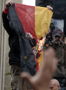 Protesters burn a German flag at parliament during a 24-hour strike in Athens on February 7, 2012.