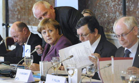 Angela Merkel and other leaders at the start of an EU summit.