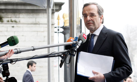 Greece's ND party leader Antonis Samaras arrives for a meeting of the EPP in Brussels