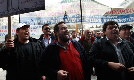 Shipyard workers shout slogans during a protest against high unemployment in their sector in Athens