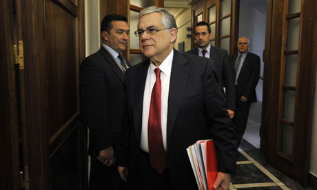 Greek prime Minister Lucas Papademos arrives for a cabinet meeting at the Greek Parliament.