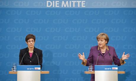 CDU candidate in the Saarland elections Annegret Kramp-Karrenbauer (L) and chancellor Angela Merkel