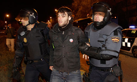 A demonstrator is arrested by police agents after he tried to stop an urban bus in Madrid, Spain.