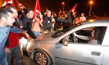 Trade union pickets block people who try to come into the Mercavalencia in Valencia, Spain.