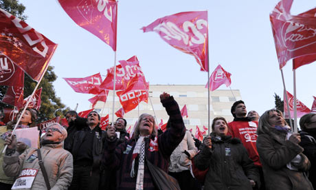 People demonstrate in front of the Gregorio Maranon Hospital in Madrid during a national strike.