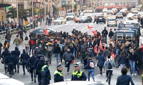 Protesters block traffic in Madrid central Gran Via avenue during a general strike.