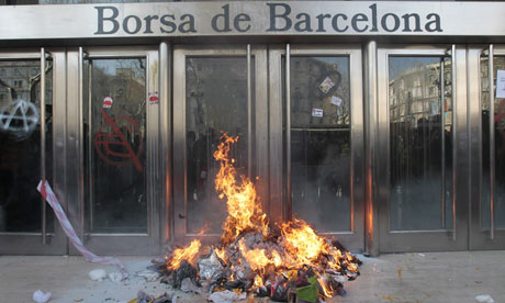 A bonfire and graffiti provoked by a picket outside Barcelona Stock Exchange 29 March 2012.