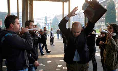 Picketers confront a public worker arriving at his workplace during Spain's general strike in Oviedo