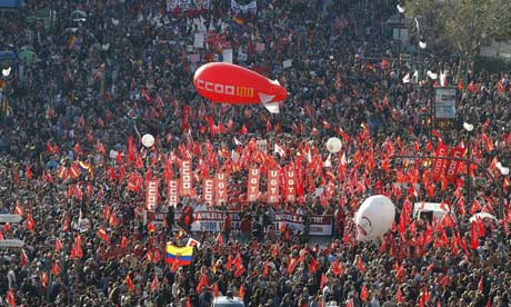 People attend a demonstration in Valencia on March 29, 2012 during a national strike.