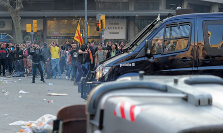 Protesters clash with riot policemen during a demonstration in Barcelona on March 29.