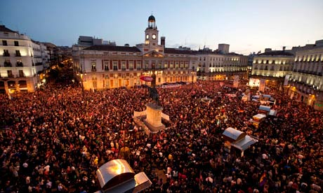 Protesters crowd Madrid's Puerta del Sol square during a rally to end a nationwide general strike