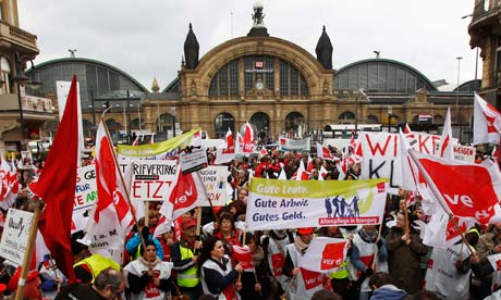 Members of union Verdi attend a demonstration during a warning strike in Frankfurt