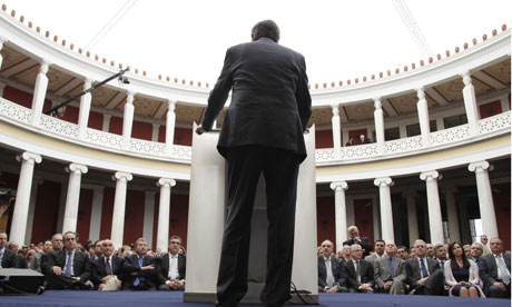 Greek conservative leader Antonis Samaras speaks to supporters