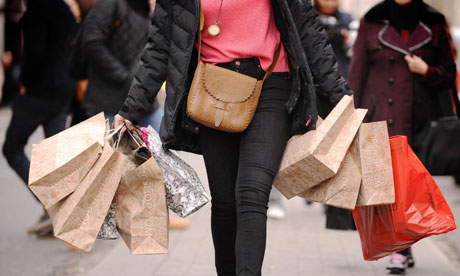 A shopper carries bags on Oxford Street
