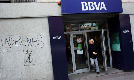 A woman walks out of a branch of Spanish second-largest bank BBVA in Madrid
