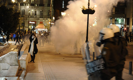 Demonstrators clash with riot police in Athens on April 4, 2012.
