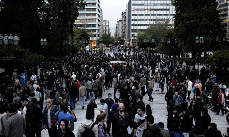 People gather at Syntagma square during a momorial ceremony for a man who shot himself there.