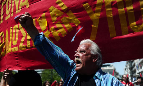 A protester shouts slogans during a demonstration in central Athens on May Day 2012