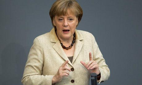 German Chancellor Angela Merkel delivers statement on her government policies in Berlin
