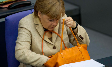 German Chancellor Merkel attends a debate after delivering statement on her government policies.