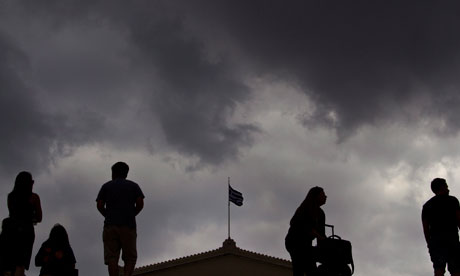 The Greek flag of the Parliament waves under heavy sky in Syntagma square, Athens, Greece