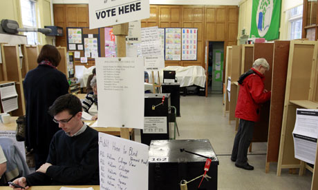 People prepare to vote at a polling station in North Dublin, Ireland.