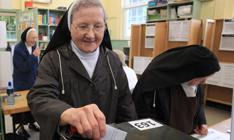 A Catholic nun casts her vote at the Drumcondra polling station in Dublin.