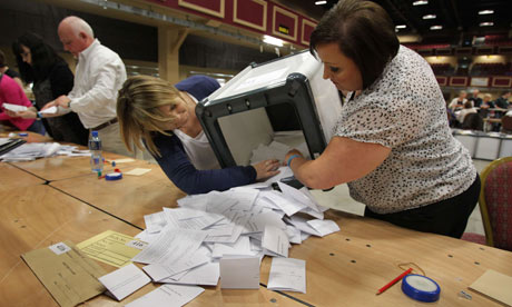 Electoral workers begin counting votes in the fiscal treaty referendum in Dublin, Ireland