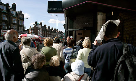 Customers queue outside a branch of Northern Rock