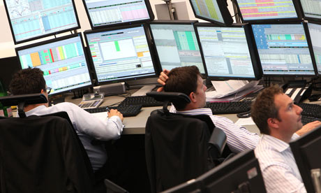 Traders work at the stock exchange in Frankfurt.