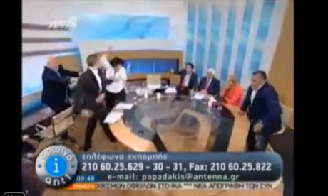 Greek Golden Dawn spokesman Ilias Kasidiaris throws a punch on live TV
