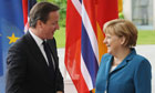 German Chancellor Angela Merkel greets British Prime Minister David Cameron in Berlin, Germany