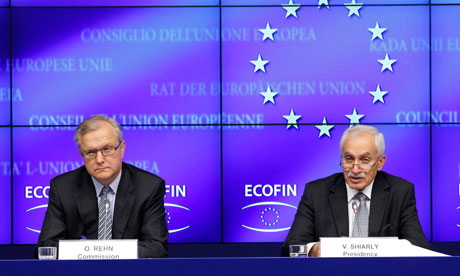 European Commissioner for Monetary Affairs Olli Rehn (L) and Cypriot Finance Minister Vassos Shiarly