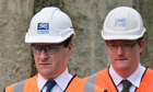 Chancellor George Osborne (L) with Treasury secretary Danny Alexander on a tour of a Crossrail site