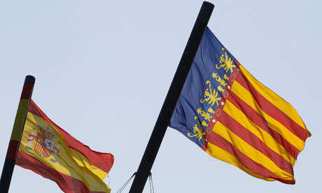 A Valencian (R) and a Spanish flag.