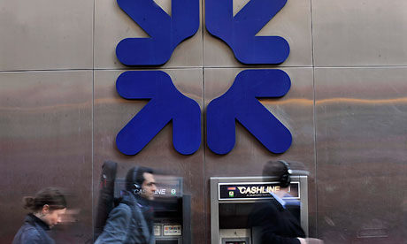 Pedestrians pass a Royal Bank of Scotland branch in London